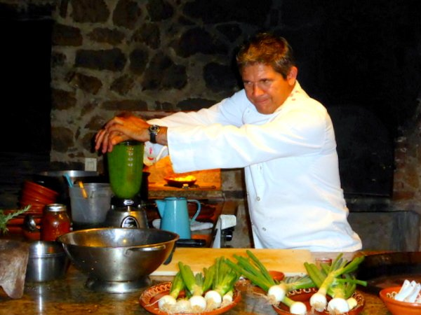 Chef Silva pureeing cilantro for green rice