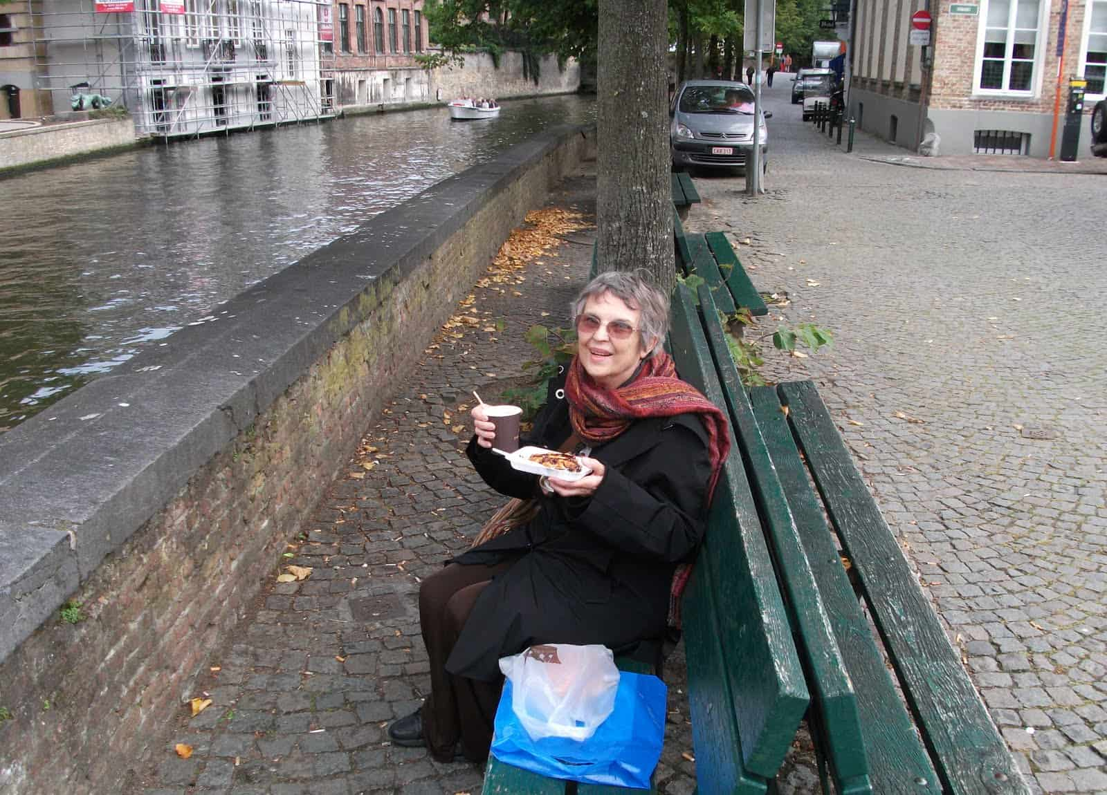 Blogger and freelance writer Vera Marie Badertscher eating a chocolate waffle in Brugge, Belgium.