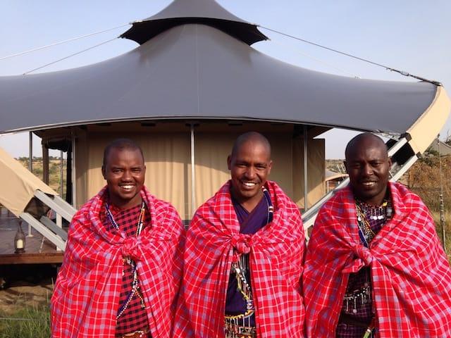 Three Maasai tribesman who work as guides at the Mahali Mzuri Safari Camp in Kenya