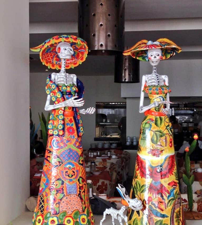 Day of the Dead figurines on display at Secrets Huatulco
