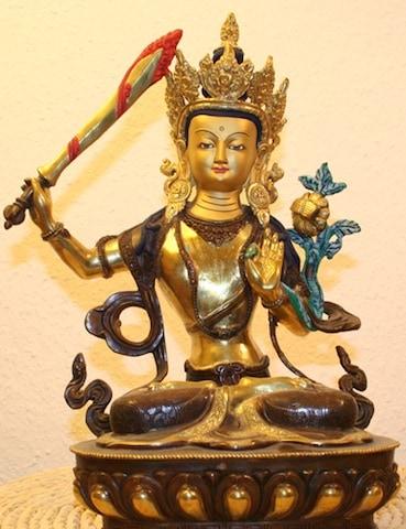 Manjushree, with Chandrahrasa, the Buddhist deity said to have created the valley.