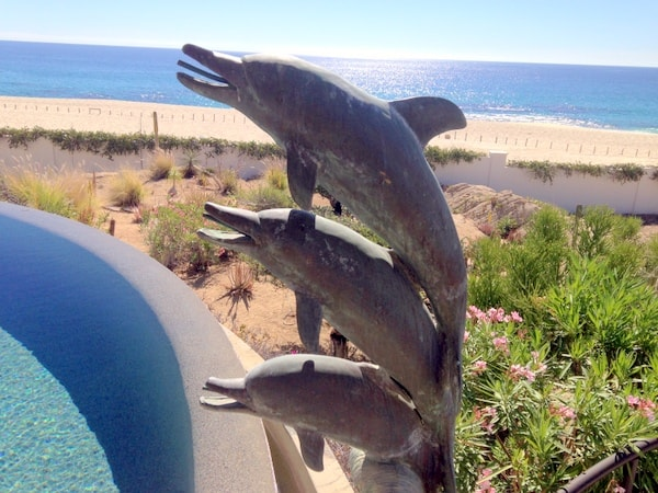 Another dolphin sculpture outdoors