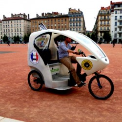 Visiting Lyon on an electric taxi tricycle