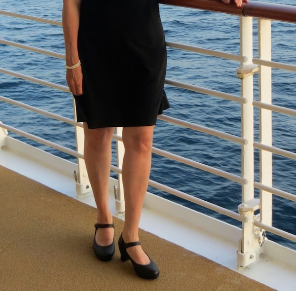 Suzanne's little black dress and black strap shoes