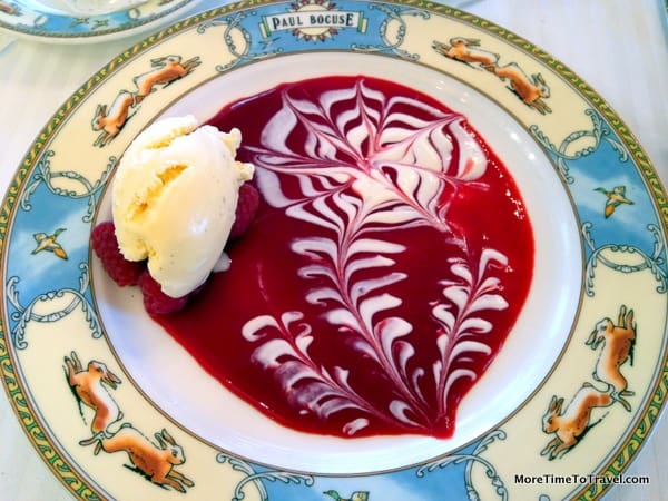 Ice cream with a raspberry coulis and cream sauce at Paul Bocuse