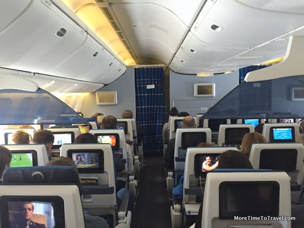 View of the cabin from the rear; economy comfort seats beyond the blue mesh