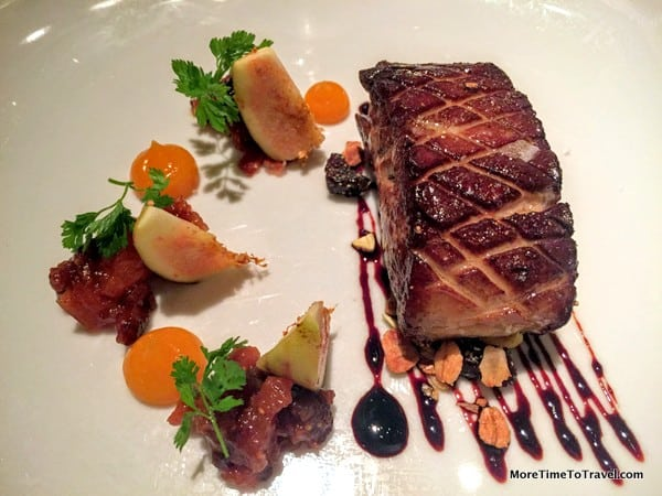 Seared Hudson Valley Foie Gras with fig chutney, cherry pistachio granola aged balsamic, apricot reduction