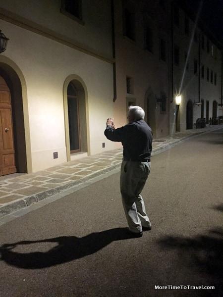 Jerry adjusting his camera to the dark in Castelfalfi, Italy (Tuscany)