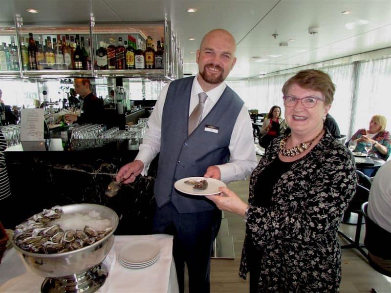 Bora serves fresh oysters to Sandra Nowlan