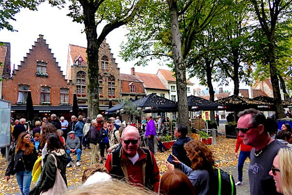 Tourists gather in Walplein, a cobble square in Bruges (Photo credit: Jerome Levine)