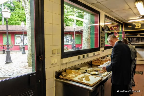 Preparing cheese in the kitchen at Paul Bocuse